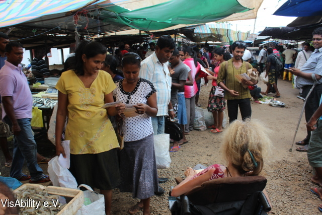 2015-07-05 VisAbility - Distribution of flyers - Market in Anuradhapura